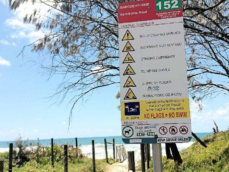 NO FLAGS: A sign at a Maroochydore beach where a 53-year-old woman drowned warns swimmers not to enter unpatrolled waters.
