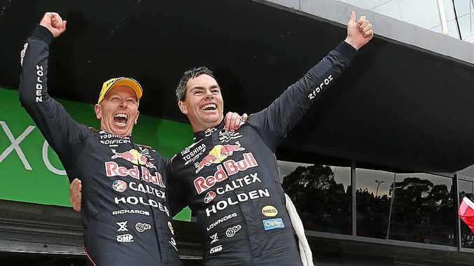 CHAMPAGNE RUN: Steven Richards and Craig Lowndes, of the 888 Red Bull Racing Australia Holden, celebrate their Bathurst 1000 win.