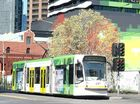 A colourful tram up Swanston St.