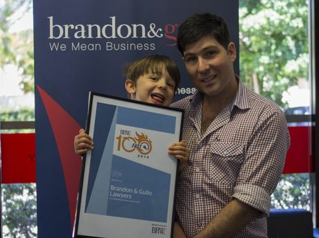 DELIGHTED: Ashley Gullo, with his son Joseph, are celebrating the listing of Brandon & Gullo law firm on the BRW Fast 100. Photo Contributed
