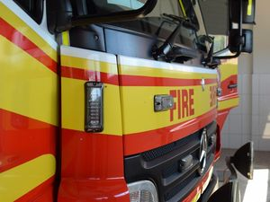 Garden shed burns as hinterland grass fire blazes