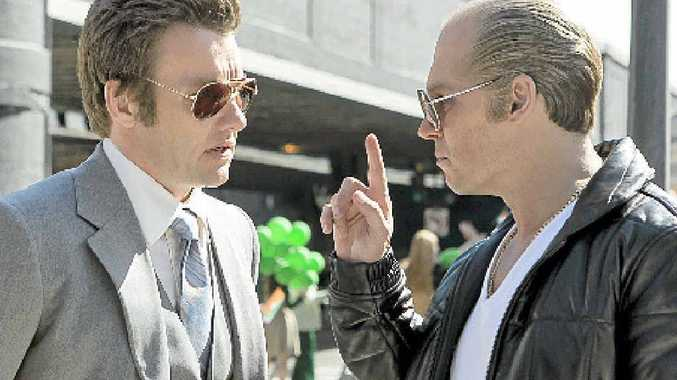 Joel Edgerton and Johnny Depp in a scene from the movie Black Mass.