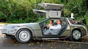 TIME OF THEIR LIFE: Joel Whipp and wife Kezia with the Delorean on their wedding day.