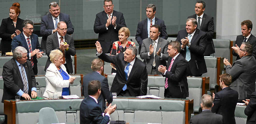 PLUM JOB AWAITS: Joe Hockey receives a standing ovation after giving his valedictory speech in the House of Representatives yesterday.