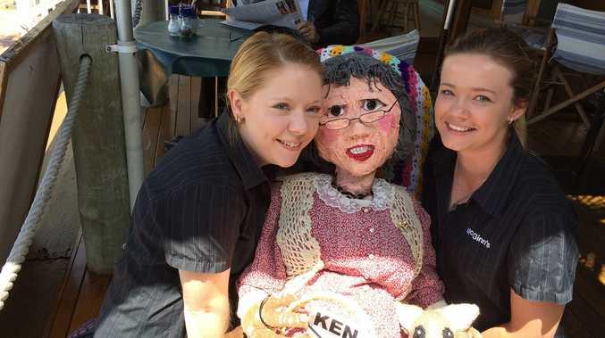 Nanna McGinns staff members Rebecca Pickett and Jamaica Atkinson pose with the Nanna McGinn scarecrow created by Linda Green.