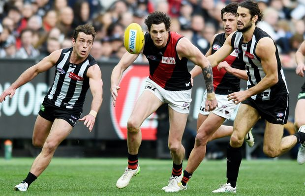 Jake Carlisle of the Bombers during the round 23 AFL match between the Collingwood Magpies and the Essendon Bombers, played at the MCG in Melbourne, Sunday, Sep. 6, 2015.