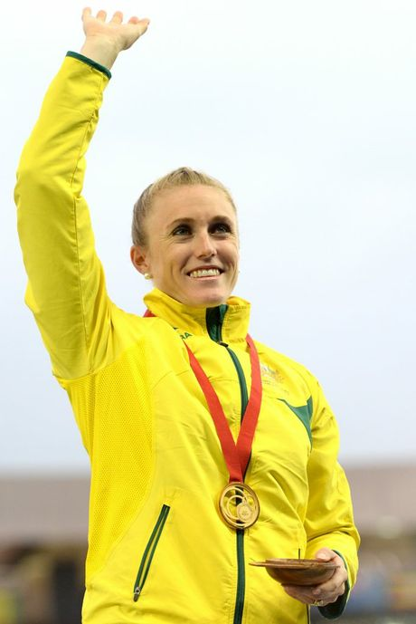 Gold medalist Australia's Sally Pearson waves during the medal ceremony for the women's 100m Hurdles final at Hampden Park during the XX Commonwealth Games, in Glasgow, Scotland, Saturday, Aug. 2, 2014. (AAP Image/Dean Lewins) NO ARCHIVING, EDITORIAL USE ONLY