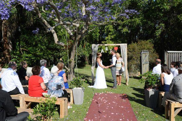 Anthony Campbell organised a secret back yard wedding for his bride Lilli Schall at Bli Bli. Photo: Warren Lynam / Sunshine Coast Daily