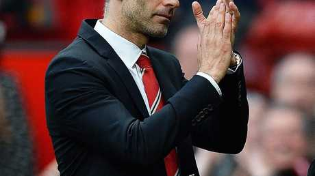 epa04181313 Manchester United's interim manager Ryan Giggs applauds supporters after the English Premier League soccer match between Manchester United and Norwich City at Old Trafford in Manchester, Britain, 26 April 2014. ManU won 4-0. EPA/PETER POWELL DataCo terms and conditions apply. http://www.epa.eu/files/Terms%20and%20Conditions/DataCo_Terms_and_Conditions.pdf