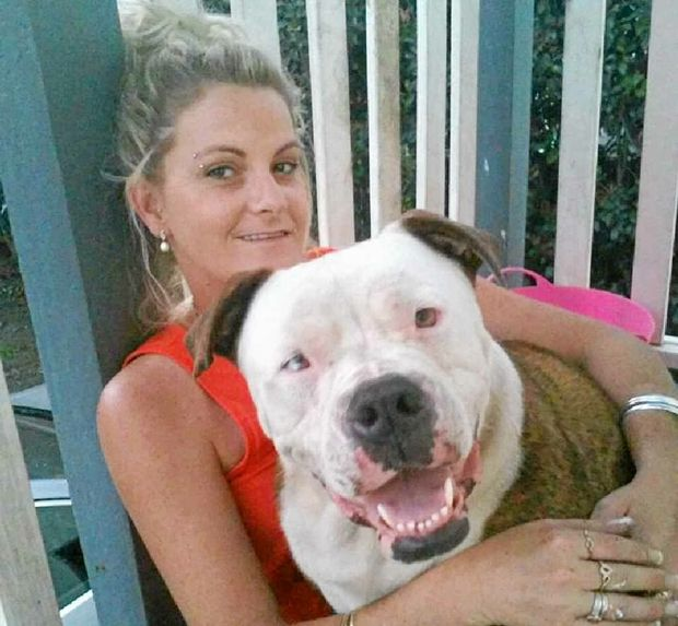 REUNITED: Angela Clark with Dukey, who was stolen from his yard in Bundaberg and dumped by a highway in Dalby.
