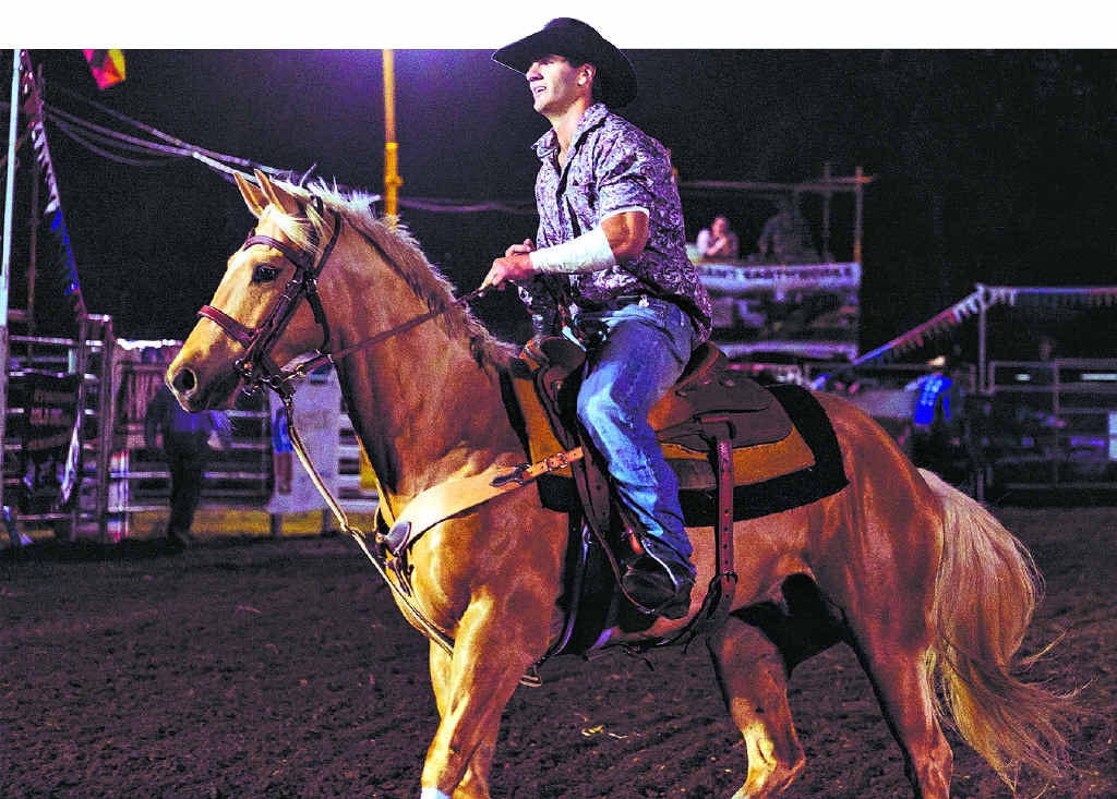 HOME GROWN: Local cowboy Owen Lee performs a victory lap after placing first in round one of the open bareback ride at the Proserpine Lions Rodeo for Suicide Prevention on Friday night.