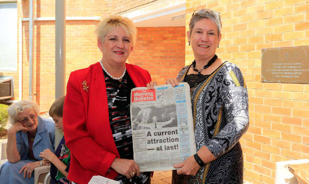 READ ALL ABOUT IT: Michelle Landry and Director of Nursing Lesley Schneider uncover an early edition of the Morning Bulletin found in a time capsule.