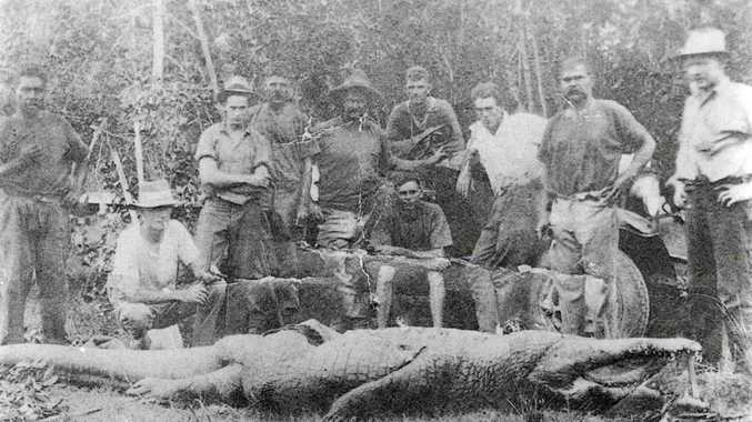 A group poses with the large crocodile that attacked two schoolgirls as they rode across Alligator Creek in March 1933. The men are (from left) Fred Murray, G. Gallagher, T. Biggs, Ted Zunker, Bill Adams, R. Pearce (sitting), P. Butterworth, Bill Schofield, Ted Rennels and Mr Patterson.