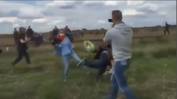 The moment a Hungarian camerawoman deliberately tripped a Syrian refugee.