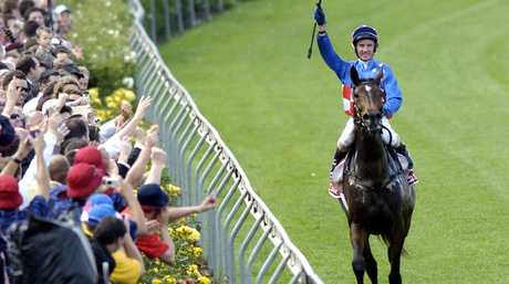Champion salutes ... Jockey Glen Boss celebrates after winning the Cox Plate on Makybe Diva at Moonee Valley Racecourse in  2005. Photo: AAP Image/Julian Smith