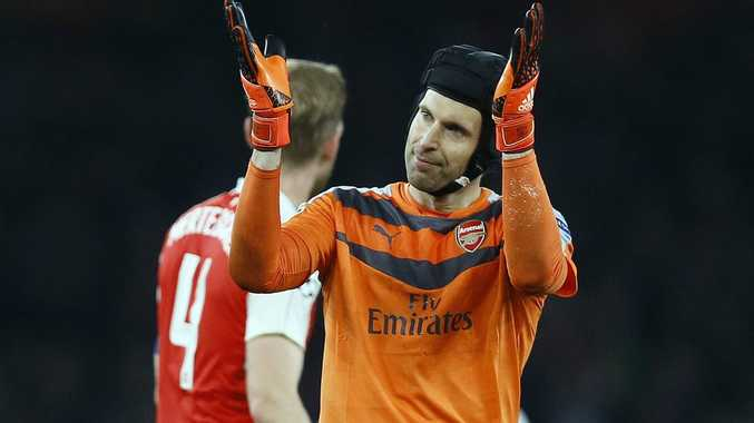 Arsenal goalkeeper Petr Cech applauds supporters after his team won the Champions League Group F soccer match against Bayern Munich at Emirates stadium in London on Tuesday. Photo: AP Photo/Kirsty Wigglesworth.