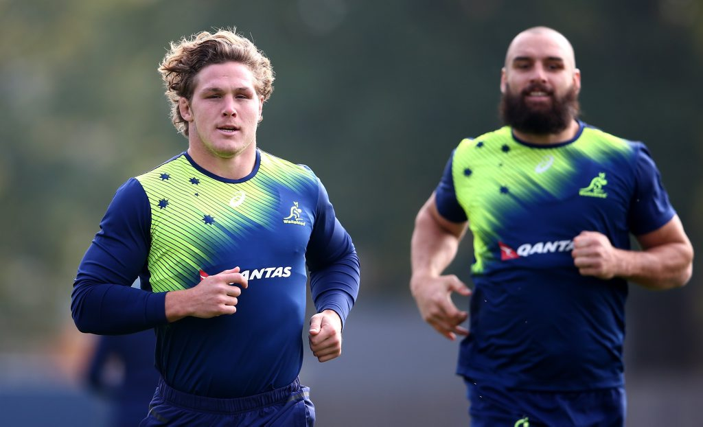 Ready to go ... Michael Hooper and Scott Fardy  warm up during a Wallabies training session at The Lensbury Hotel  in London. Photo: Dan Mullan/Getty Images.