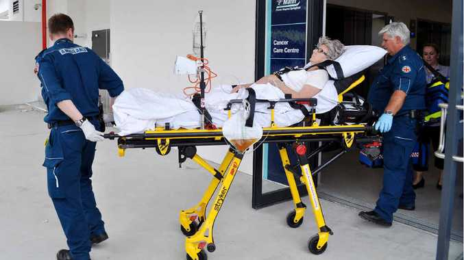 TEST RUN: Queensland Ambulance Officers simulate a patient transferral to the Mater Brisbane.