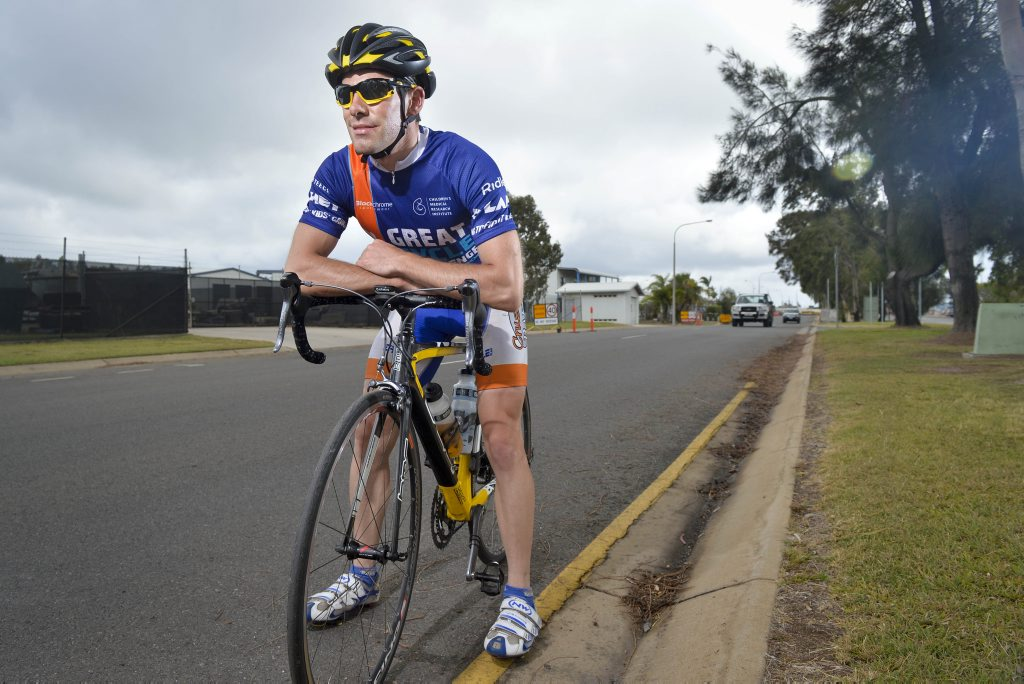 WET AND WILD: Simon Ackling, a 26-year-old electrician, rode nonstop for 24 hours around the Gladstone Marina for charity.