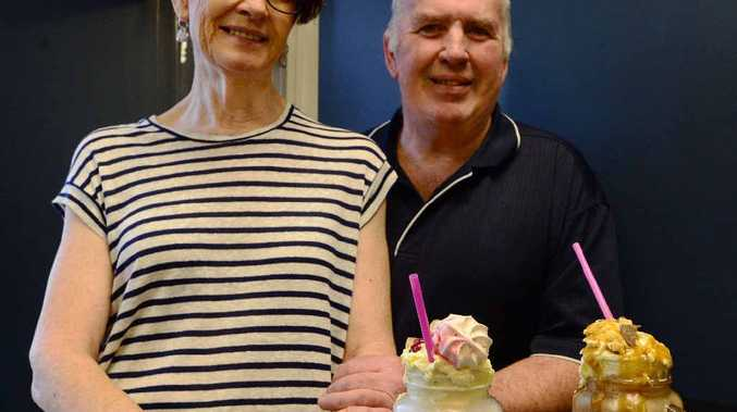 MILKING IT UP: David and Cheryl Pitchford from Billy Blue's Café with two of the new additions to the menu, the Riley Shake and the Banoffee Shake.