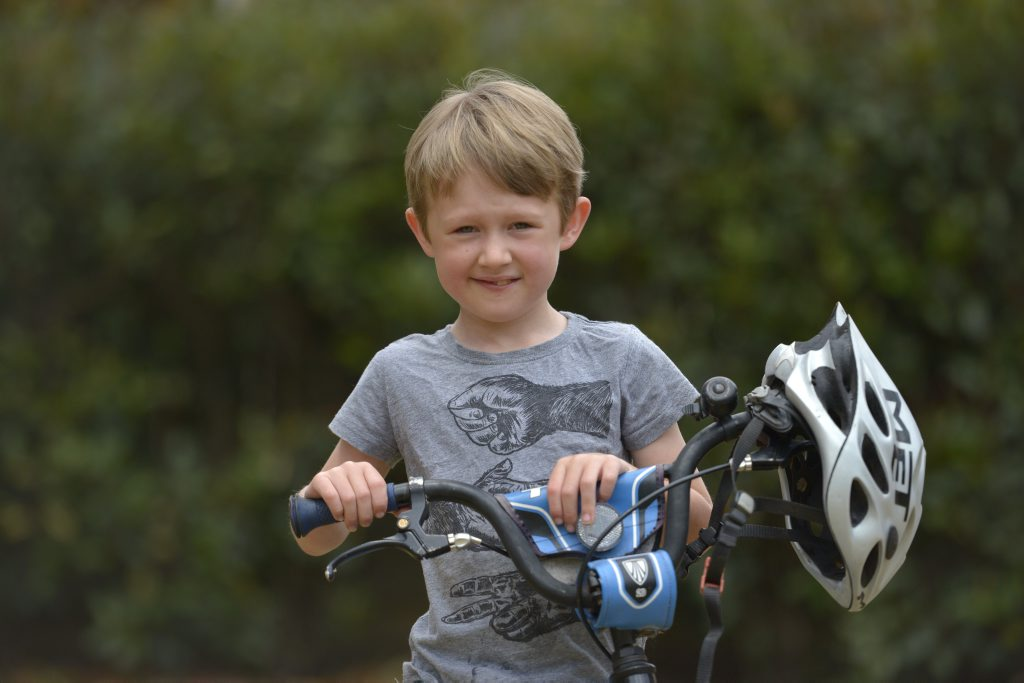 FAVOURITE THINGS: Riding his bike is one of seven-year-old Max Bennett's past times. He is home with his family after spending time in hospital with a rare neurological disorder. Photo Bev Lacey / The Chronicle
