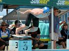 Mackay Swimming Academy star Darcy Hargreaves leaps from the blocks in the 16 boys' 100m freestyle race, which he won gold in at the Great Barrier Reef Swim Meet.