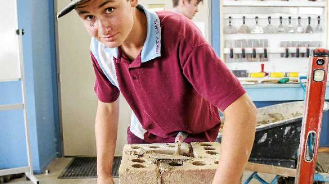 TRY-A-TRADE: Oakey State High School student John Munchow squaring off his small pillar at the brick laying workshop.