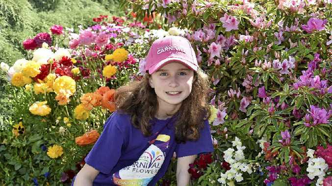 PRETTY AS A PICTURE: The granddaughter of Bob and Val Ford, Sienna Deurloo, in their Burke St garden.
