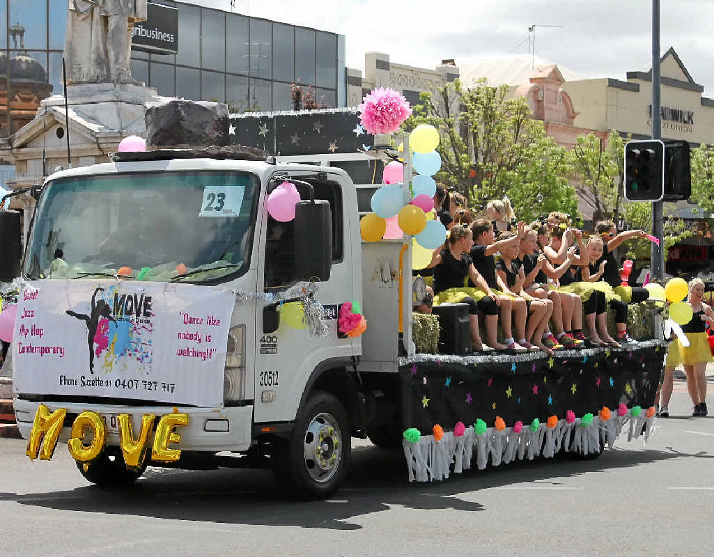 DANCING FIREFLIES: Move School of Dance wins best in theme at the rodeo street parade.