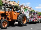 PARADE WINNERS: Warwick Central State School students wave from their Bug Life float as winners of the best float in the Parade.