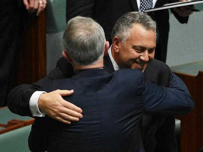 Former treasurer Joe Hockey hugs Prime Minister Malcolm Turnbull after making his valedictory speech in the House of Representatives at Parliament House in Canberra on Wednesday, Oct. 21, 2015.
