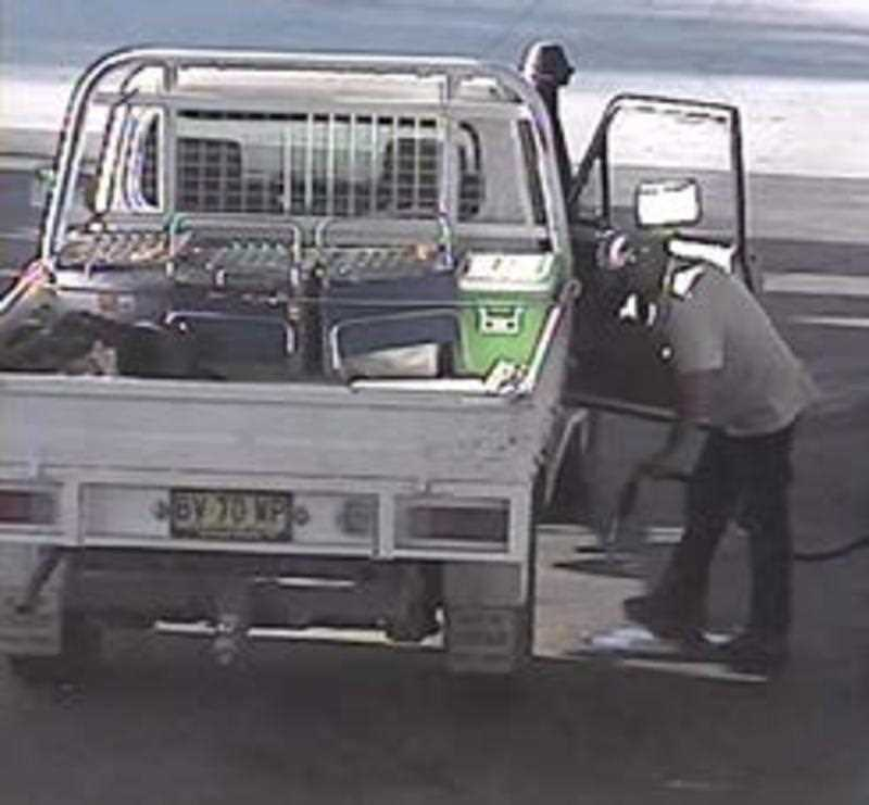 A supplied image obtained Sunday, Oct. 25, 2015 of a van believe to belong to father and son Gino and Mark Stocco who two of Australia's most wanted fugitives. Police have confirmed that on-the-run father and son were last seen in a stolen white Toyota Landcruiser that has now been disguised with a cover and is bearing stolen South Australian plates S415 AZL.