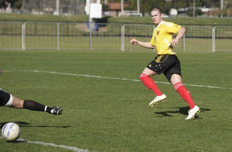 Football: Sunshine Coast Fire FC v Bundaberg Spirit at Sunshine Coast Stadium. Gareth Musson kicks a goal past the keeper.