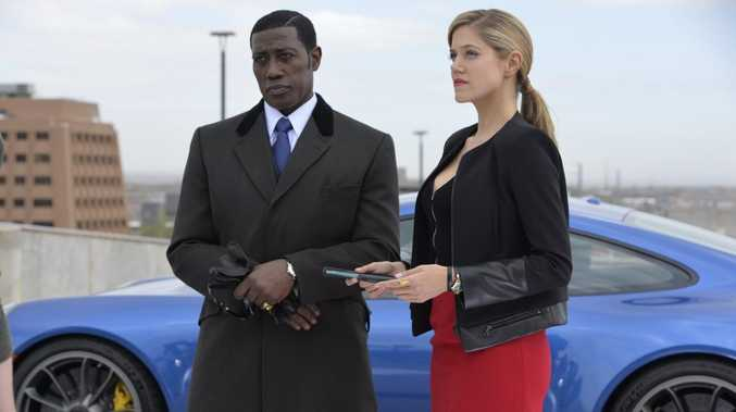 Wesley Snipes and Charity Wakefield in a scene from the TV series The Player.