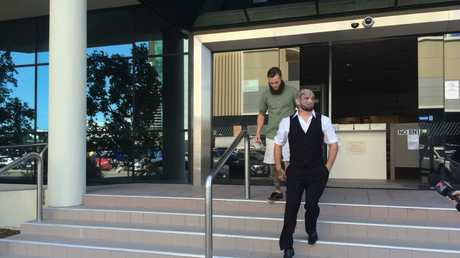 Nathan Leonard Richards, wearing a vest and with face tattoos, walks from Maroochydore District Court after being given immediate parole for an attack on a security guard at Kawana Shoppingworld.
