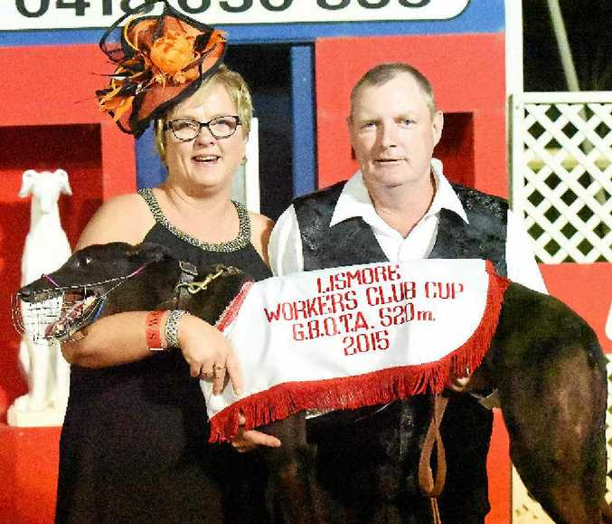 HAPPY FAMILY: Toni and Charlie Northfield celebrate with Kingsbrae Nelly after their greyhound's memorable victory in the Lismore Workers Club Cup.