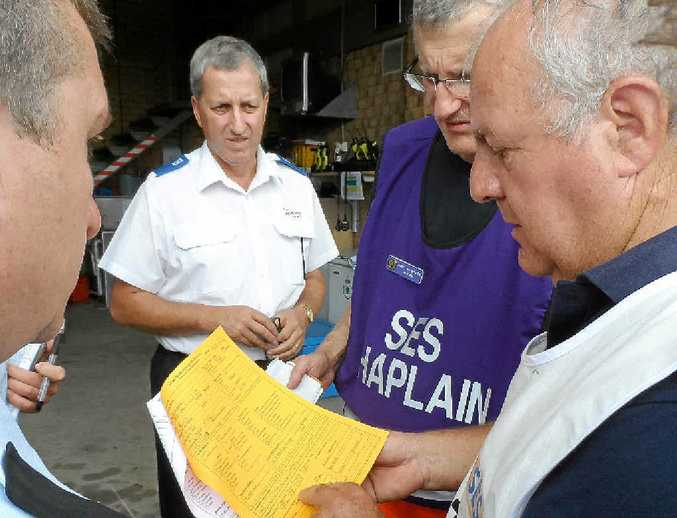 GODSEND: SES Chaplain Paul von Bratt (second from right) helps emergency service workers deal with trauma.