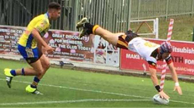 CQ NRL Bid under-15 development team member Tommy Farr goes in for a try in the corner against Parramatta.