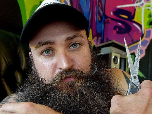 HIRSUTE: Harrison Mallory from Scumbag Barber Shop in Noosa is going to an international beard competition in America.
