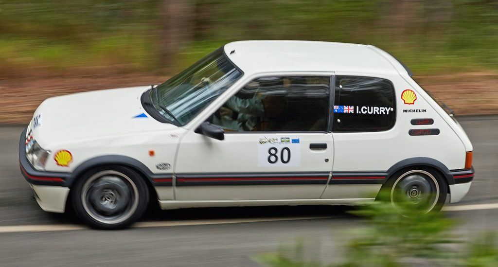 FRENCH FLYER: Iain Curry's classic Peugeot 205 GTi on a charge at the 2015 Mid Year Noosa Hill Climb. He looks faster than he really is. Photo: Tony MacKenzie