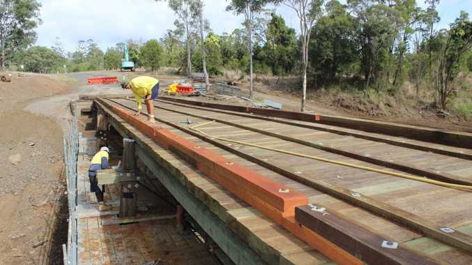 Almost there: The council bridge crew staff are pictured applying the finishing touches to the Pine Creek Bridge which is scheduled to be reopened for public use on Friday. Photo Contributed