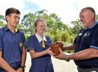 Maroochydore RSL is donating a Lone Pine tree from the memorial in Turkey to Immanuel Lutheran College. Presenting the tree. (from left) College Captain James Rafter, College Vice Captain Sarah Ward and Maroochydore RSL President Michael Liddelow. Photo: Che Chapman / Sunshine Coast Daily
