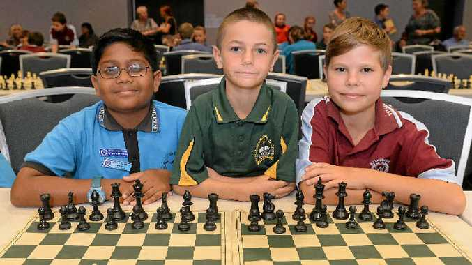 COMPETITIVE PLAYERS: Adheesha Suraweera, Cody Scanky and Reece Buckholz at the chess tournament. Photo: Mike Knott / NewsMail