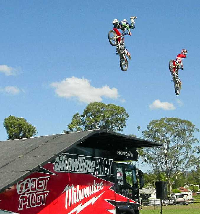 UP THERE: Stunt riders Brad Burch and Kain Saul at last weekend's 24th Woodenbong Trail Ride.