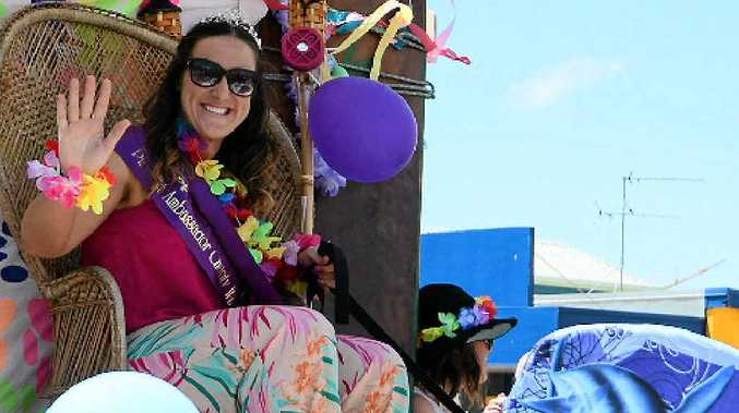 CROWNED: Pinefest Ambassador 2015 Grace Scantlebury takes pride of place during the parade on Sunday.