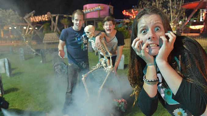 SCAREDY CATS: Shaylie Brown (front) with Riley Cope and Benjamin Newall are getting ready for Halloween celebrations at Aussie World.