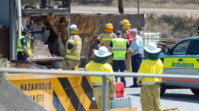 Police and firefighters examine the kiln which exploded killing a worker at Veolia environmental services. Photo Mike Richards / The Observer