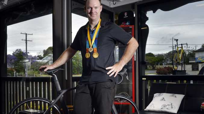 MAGIC MOMENTS: Sport Australia Hall of Fame inductee and Olympic gold medallist Ryan Bayley was a proud sportsman returning to work at Ipswich's Yellow Jersey Bike Shop.