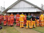 SES and Rural Fire Brigade volunteers gather at the command centre.