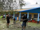 Workers clean up the debris at the Fernvale Goodstart Childcare Centre